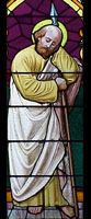 [stained glass images of the saints]