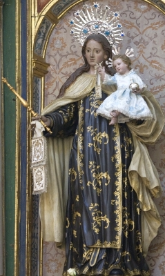 statue of Our Lady of Mount Carmel, Carmelite convent of the Incarnation in Avila, Spain; Our Lady of Mount Carmel is shown wearing the habit of the Carmelite Order; in her left hand she holds the infant Christ, and in her right hand, the brown scapular in the form it is worn by most people today; swiped with permission from the flickr account of Father Lawrence Lew, OP