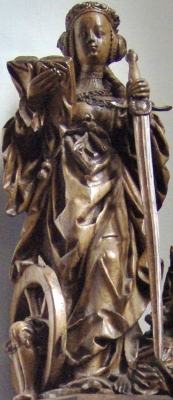 15th century wooden sculpture of Saint Catherine of Alexandria in the Sankt Franziskuskirche, Zwillbrock, Germany; swiped off Wikipedia