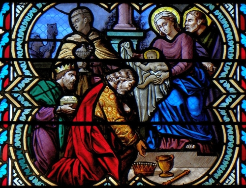 detail of a stained glass window depicting the Adoration of the Magi, date and artist unknown; church of Saint-Pierre, Dourdain, France; photographed on 8 December 2013 by GO69; swiped from Wikimedia Commons