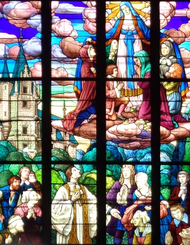 detail of a stained glass window depicting the meeting of Saint Louis Marie de Montfort with the Count and Countess of Garaye at Garaye Castle in 1706; by the workshop of G. Merklen, Angers, France, 1923; bay #20, south nave, Church of Saint-Malo, Dinan, Côtes-d'Armor, Brittany, France; photographed on 10 January 2017 by Emeltet; swiped from Wikimedia Commons