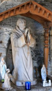 statue of Blessed Germain of Talloires, date and artist unknown; part of the shrine to Blessed Germain in the grotto de Saint-Germain de Talloires, Haute-Savoie; photographed on 28 December 2015 by B. Brassoud; swiped from Wikimedia Commons