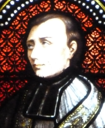 detail of a stained glass window of Blessed Jean Martin Moye; date and artist unknown; Saint-Jean-de-Bassel, France; photographed on 30 December 2013 by Paralacre; swiped from Wikimedia Commons; click for source image