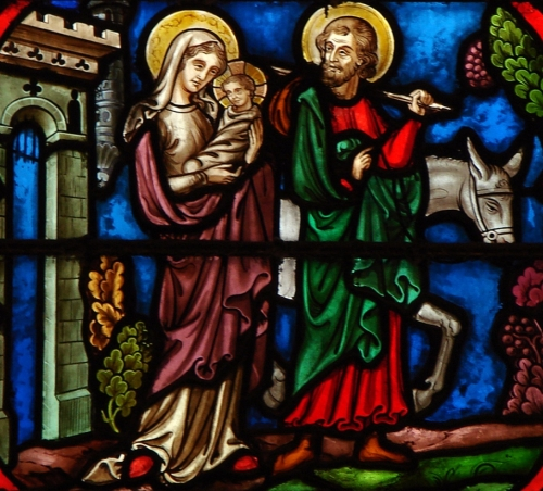 detail of a stained glass window depicting the Flight into Egypt, date and artist unknown; choir chapel, cathedral of Notre Dame de Paris, Paris, France; photographed on 19 December 2008 by Vassil; swiped from Wikimedia Commons
