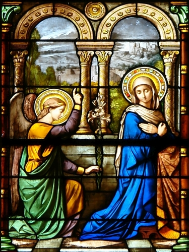 detail of a stained glass window of the Annunciation, date and artist unknown; Notre-Dame, Geneva, Switzerland; photographed on 22 April 2009 by Yann Forget; swiped from Wikimedia Commons
