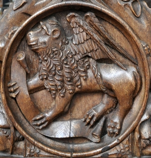 bas-relief of the lion as a symbol of Saint Mark the Evangelist; 1509, artist unknown; choir stall, abbey church, Bordesholm, Schleswig-Holstein, Germany; photographed in October 2014 by Andreas Praefcke; swiped from Wikimedia Commons; click for source image