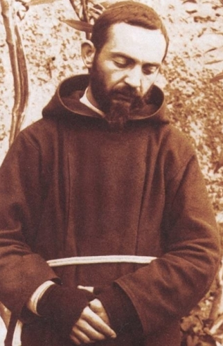 detail of a photograph of Padre Pio, date unknown; swiped from Wikimedia Commons