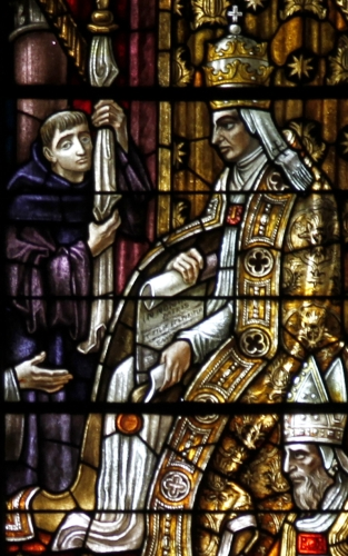 detail of a stained glass window depicting the approval of the Franciscans by Pope Honorius III; Church of San Domenico, Siena, Italy, date and artist unknown; photographed on 21 September 2016 by José Luiz Bernardes Ribeiro; swiped from Wikimedia Commons