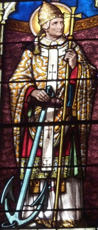 detail of a stained glass window of Pope Saint Clement I, church of Saint Clement, Arpajon, France, 1895; photographed on 6 April 2012 by GFreihalter; swiped from Wikimedia Commons
