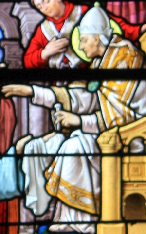 detail of a stained glass window showing Pope Saint Linus giving a nail from the cross of Saint Peter to Saint Clair of Rome; by Ch. Lorin of Chartres, 1905; Church of Saint-Clair, Réguiny, France; photographed on 1 November 2013 by XIIIfromTOKYO; swiped from Wikimedia Commons; click for source image