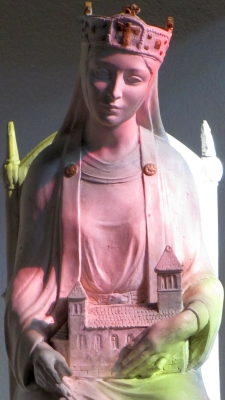 detail of a statue of Saint Adelaide, Abbess of Seltz, Alsace, France, date unknown, artist unknown; the coloring is from a stained glass window; photographed by Rh-67 in 2010; swiped off Wikimedia Commons