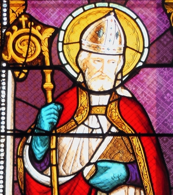 detail of a stained glass window of Saint Albinus of Angers; date unknown, artist unknown; church of Saint-Aubin, Landes, France; photographed on 23 December 2014 by Jibi44; click for source image