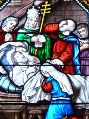 detail of a stained glass window depicting the discovery of the death of Saint Alexius of Rome, date unknown, artist unknown; Church of Saint Sulpice, Bugue, Dordogne, France; photographed on 15 September 2012 by Father Igor; swiped from Wikimedia Commons