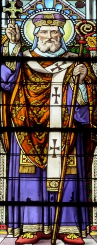 detail of a stained glass window Saint Amand of Maastricht, date unknown, artist unknown; Catholic parish church of Saint-Vincent-de-Paul, Clichy, France; photographed on 28 March 2011 by GFreihalter; swiped from Wikimedia Commons