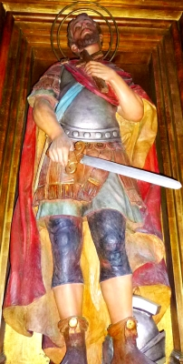 statue of Saint Anastasius of Lérida, Church of Santa Maria, Badalona, Spain; date unknown, artist unknown; photographed on 2 September 2014 by Zarateman; swiped from Wikimedia Commons; click for source image