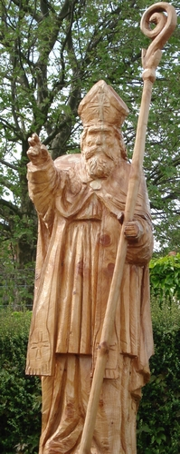 chainsaw sculpture of Saint Avitus of Vienne by Adrien Meneau, date unknown; Saint-Avit, Drôme, France; photographed on 9 May 2008 by Gachepi; swiped from Wikimedia Commons