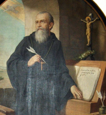 detail of a painting of Saint Benedict of Nursia writing