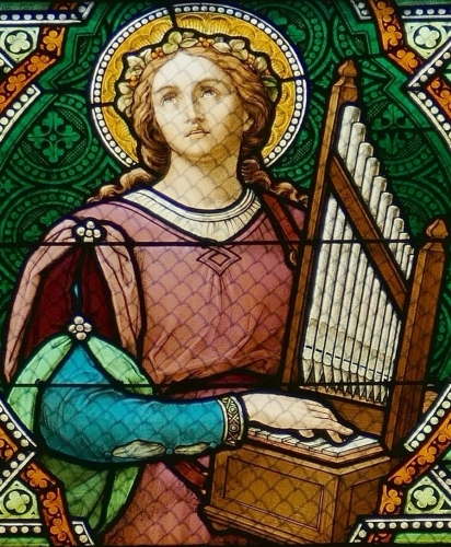 detail of a stained glass window of Saint Cecilia, church of Saint-Alexis de Griesheim-près-Molsheim, Alsace, Bas-Rhin, France; by Ott Frères, 1914; photographed on 21 September 2016 by Ralph Hammann; swiped from Wikimedia Commons
