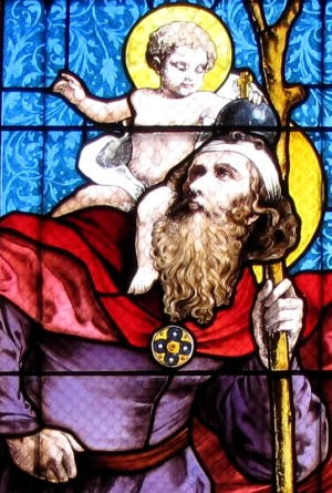 detail of a stained glass window of Saint Christopher by Ott Frères, 1911; church of Saint Laurent, Verrière, France; photographed in 2012 by Ralph Hammann; swiped from Wikimedia Commons