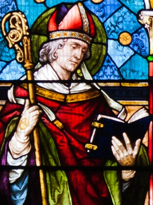 detial of a stained glass window depicting Saint Colman of Cloyn