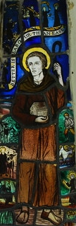 stained glass window of Saint Cybi, date unknown, artist unknown; church porch, Eglwys Beuno Sant Penmorfa, Gwynedd, Wales; photographed on 17 June 2007 by Alan Fryer; swiped from Wikimedia Commons