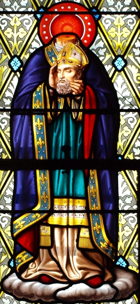 detail of a stained glass window of Saint Denis of Paris; date and artist unknown; cemetery chaple of the Croix-Bouessée, Piré-sur-Seiche, Ille-et-Villaine, France; photographed on 13 December