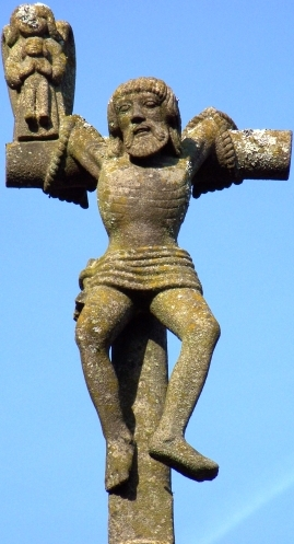 statue of Saint Dismas, the good thief; date and artist unknown; Plougastell Daoulaz, Finistere, Brittany, France; photographed on 10 April 2010 by Farz brujunet; swiped from Wikimedia Commons; click for source image