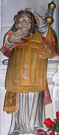 statue of Saint Elophe carrying his severed head; 1709, artist unknown; inside the church at Domrémy-la-Pucelle
