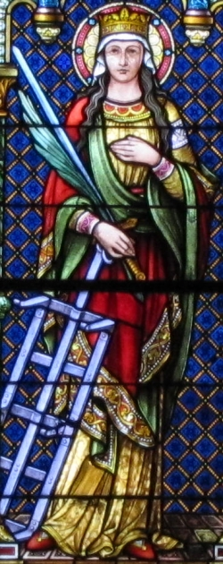 detail of a stained glass window of Saint Faith; Ott Brothers, 1892; church of Sainte-Foy, Sélestat, France; photographed on 2 July 2011 by Rh-67; swiped from Wikimedia Commons; click for source image
