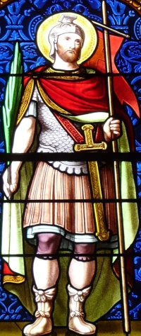 detail of a stained glass window depicting Saint Ferreol; designed by Félix Gaudin, date unknown; Saint-Ferréol church Murol, Puy-de-Dôme, France; photographed on 24 June 2013 by Father Igor; swiped from Wikimedia Commons; click for source image