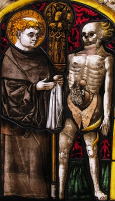 detail of a stained glass window of Saint Fridolin; date unknown, artist unknown; swiped from Wikimedia Commons; click for source image