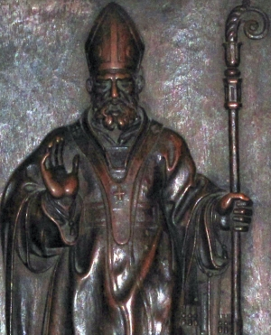 detail of a wooden bas-relief of Saint Glycerius of Milan; c.1600, artist unknown; choir of the Cathedral of Milan, Italy; photographed on 13 October 2012 by A ntv; swiped from Wikimedia Commons; click for image source