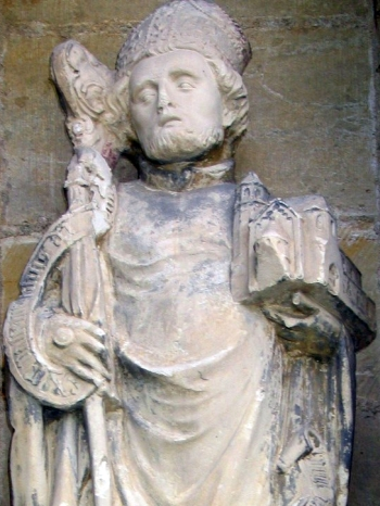 detail of a statue of Saint Godehard of Hildesheim; date unknown, artist unknown; northwest portal, Cathedral of Hildesheim, Germany; photographed on 24 May 2005 by Hildesia; swiped from Wikimedia Commons; click for source image
