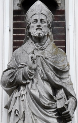 detail of a sculpture of Saint Gregory of Utrecht at the Kromme Nieuwegracht, Saint Gregorius College, placed in 1909, artist unknown