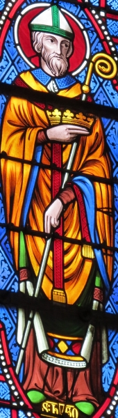 detail of a stained glass window of Saint Hugues; date unknown, artist unknown; Basilica of Bonsecours, France; photographed on 13 September 2012 by Giogo; swiped from Wikimedia Commons; click for image source