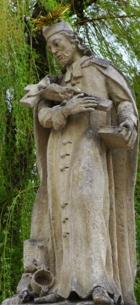 statue of Saint Jan Sarkander; c.1869, artist unknown; Saint John of Nepomuk and Blessed Jana Sarkander bridge, Rokytka, Smetana, Peroutka, Moravian Budejovice, Czech Republic; photographed on 21 April 2014 by Koutne1; swiped from Wikimedia Commons; click for source image