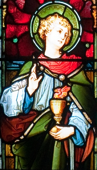 detail of a stained glass window of Saint John the Apostle; by Augustus Welby Northmore Pugin, mid-19th century; west aisle, Saint Aidan's Cathedral, Enniscorthy, County Wexford, Ireland; photographed on 28 September 2009 by Andreas F. Borchert; swiped from Wikimedia Commons; click for source image