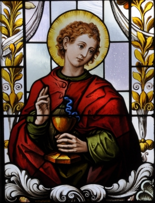 detail of a stained glass window of Saint John the Apostle; 19th century by F X Zettler, Munich, Germany; parish church of Saint Alban, Gutenzell-Hürbel, Biberach, Germany; photographed in January 2015 by Andreas Praefcke; swiped from Wikimedia Commons; click for source image
