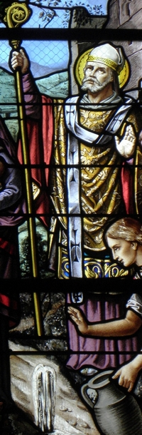 detail of a stained glass window of Saint Julian of Le Mans; date and artist unknown; church of Saint-Pierre de Chevaigné, France; photographed on 14 September 2013 by GO69; swiped from Wikimedia Commons