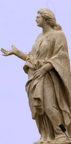 statue of Saint Juliana of Ptolemais by Giovanni Pietro Mauri, c.1703; cololnnade of Saint Peter's Basilica, Rome, Italy