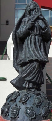 photograph of a statue of Saint Kareti Tekakwitha, Holy Cross School, Mission San Buenaventura, Ventura, California; artist unknown; photographed on 29 December 2012 by H