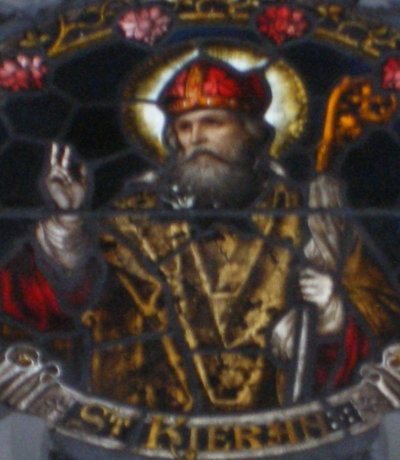 detail of a stained glass window of Saint Kieran, date and artist unknown; Church of Seir Kieran, Bell Hill, Offaly, Ireland; photographed on 25 January 2015 by Clareen72; swiped from Wikimedia Commons