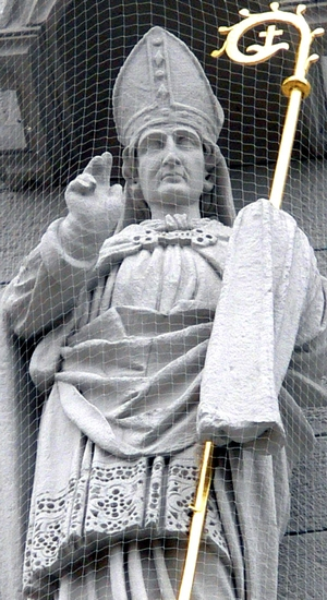 detail of a statue of Saint Kilian; 1890 by Josef Metzger; facade of Knights Chapel, Haßfurt, Lower Franconia, Germany; photographed on 30