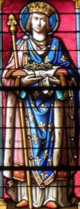 detail of a stained glass window of Saint Louis IX, King of France; date and artist unknown; north window, Basilique Notre-Dame de La Guerche-de-Bretagne; photographed on 28 August 2011 by GO69; swiped from Wikimedia Commons; click for source image