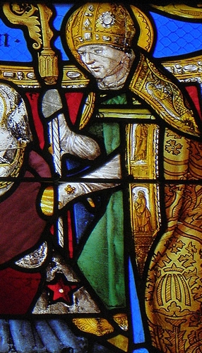 detail of a stained glass window of Saint Lucinus of Angers; date and artist unknown; Church of Saint-Lézin, La Chapelle-Janson, France; photographed on 15 August 2014 by GO69; swiped from Wikimedia Commons