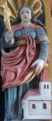 detail of a statue of Saint Lüfthildis; date and artist unknown; altar of the church of Saint Lüfthildis, Kesseling, Germany; photographed on 16 November 2010 by Reinhardhauke; swiped from Wikimedia Commons; click for source image