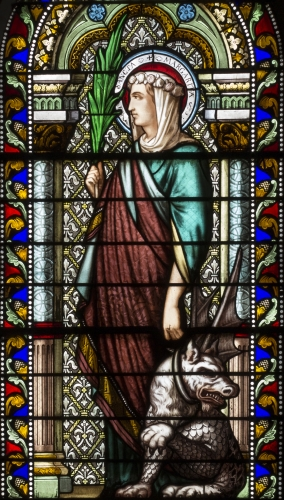 detail of a stained glass window of Saint Margaret of Antioch, date and artist unknown; church of Saint-Denis-de-la-Croix-Rousse in Lyon, France; photographed on 29 October 2015 by Xavier Caré; swiped from Wikimedia Commons; click for source image