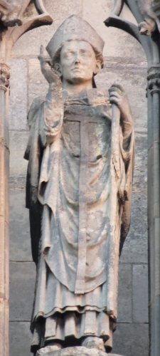 statue of Saint Maurille, Archbishop of Rouen, date and artist unknown; 5th statue on the right of the gallery of the western facade of the cathedral of Rouen, France; photographed on 6 December 2014 by Giogo; swiped from Wikimedia Commons