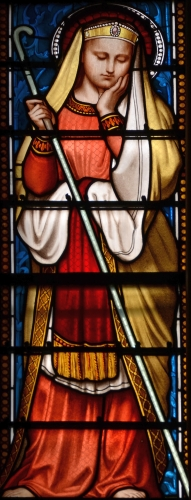 detail of a stained glass window of Saint Regina, date and artist unknown; Basilica of Ars, France; photographed on 21 October 2015 by Vassil; swiped from Wikimedia Commons