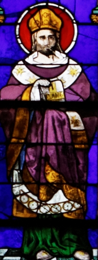 detail of a stained class window of Saint Ronanus of Quimper; date unknown, artist unknown; Saint Corentin Cathedral, Quimper, Brittany, France; photographed on 27 July 2013 by Thesupermat; swiped from Wikimedia Commons